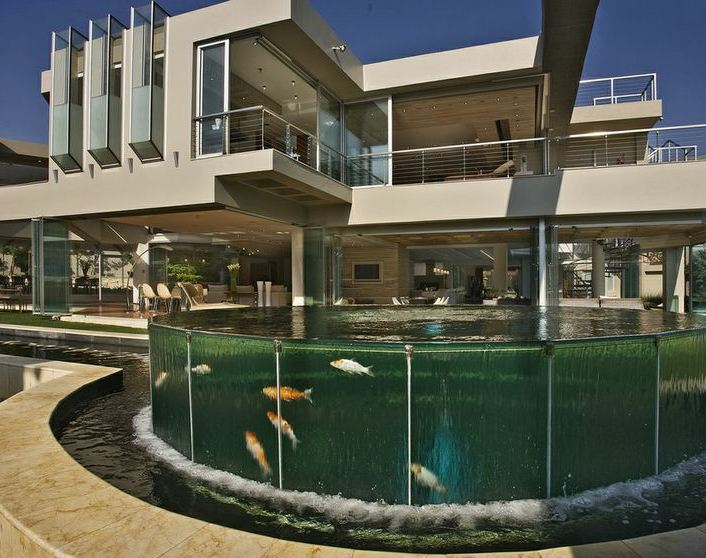immoafrica-architecture-delightful digs-nico van der meulen-glass house-pond day